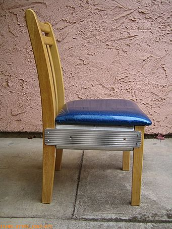 Strange looking aluminum, vinyl, and wood chair